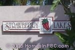 sign in front of Strawberry Lakes in Lake Worth
