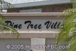 sign in front of Pinetree Village in Boynton Beach