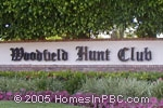 sign in front of Woodfield Hunt Club in Boca Raton