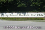 sign in front of Carriage Homes at Woodfield Hunt Club in Boca Raton