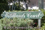 sign in front of Woodlands Court in Boca Raton