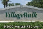 sign in front of Village Walk at Wellington in Wellington