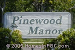 sign in front of Pinewood Manor in Wellington