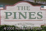 sign in front of Pines of Wellington in Wellington