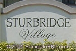 sign in front of Sturbridge Village in Wellington