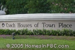 sign in front of Coach Houses of Town Place in Boca Raton