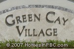 sign in front of Green Cay Village townhomes in Boynton Beach