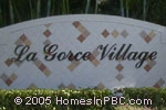 sign in front of LaGorce Village in Lake Worth
