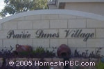 sign in front of Prairie Dunes Village in Lake Worth