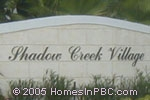 sign in front of Shadow Creek Village in Lake Worth