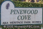sign in front of Pinewood Cove / Heritage Park Homes in Delray Beach