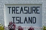 sign in front of Treasure Island in Boynton Beach