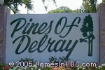 sign in front of The Pines of Delray in Delray Beach